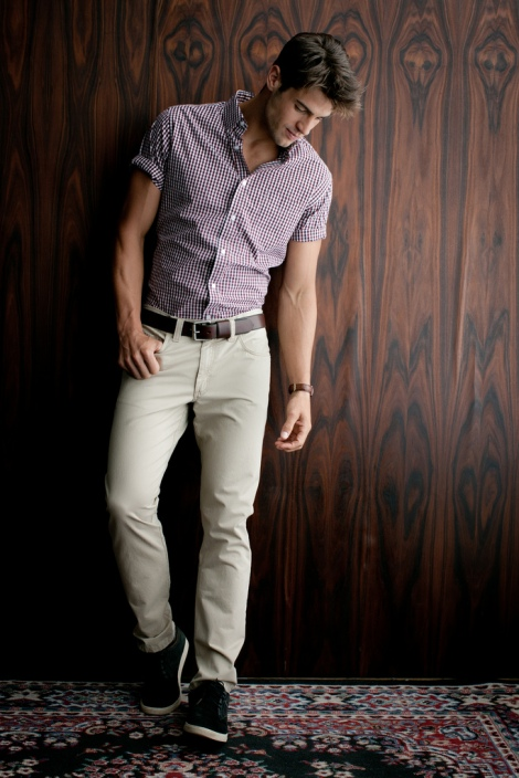 Men's Fashion Colorful Button Down with Rolled Sleeves Khaki Pants Belt Tennis Shoes Area Rug Wood Walls